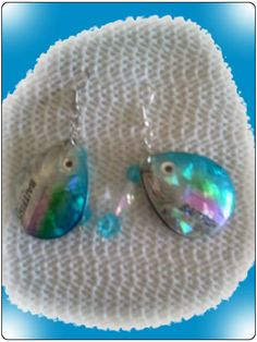 http://diginanchors.com/EarringsAlure_BlueRay - These dangle earrings are crafted from Fishing Lures made of high grade carbon steel and painted a beautiful acquamarine blue like the deeps of the Gulf of Mexico. The handmade jewelry then has sparkling acquamarine blue crystal beads added and hung on  The drop earrings are hung on surgical stainless steel earwires or silver plated brass clip-ons.