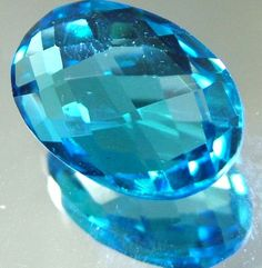 LONDON BLUE TOPAZ --CUT BOTH SIDES -VS- 8.92 CTS [TS816 ]  Cut Oval     Grading VS   Size  15 x  10 x  7 mm app   Weight  8.92  cts app