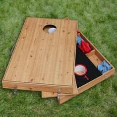 """Having two games is always more fun than one. The Washer Toss  Bean Bag Toss Lawn Games Combo comes with two-two sided game platforms. This set includes nets to catch the bags and waskers, rotatable legs to support the boards, and padded surfaces for the two washer boards. The Washer Toss  Bean Bag Toss Lawn Games Combo include six bags (4"""" x 4"""") and six washers. $44.95"""