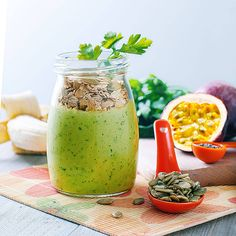 Chia seeds, banana, pumpkin seeds, oats, passion fruit, parsley, almond milk and spinach smoothie