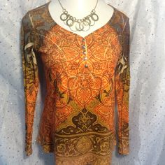 One World Knit Top with Bling Gorgeous colored sublimation long sleeve Henley.  Chest has coordinating bling.  One World has beautifully unique designs and color combinations.  Great quality, excellent pre-loved condition.  100% polyester. ONE WORLD Tops Tees - Short Sleeve