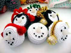 These are snowmen and Penguins made with tea lights.   Size 10 thread and size 7 hook.  snowmen in Crochet World December 2014 penguins in Annie's Attic A Christmas Crochet