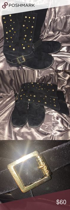 Michael kor boots Studded with stars Michael KOR leather boots with buckle very good shape still have lots of life left zipper up the side gorgeous boots size 6 runs small on me Michael Kors Shoes Heeled Boots