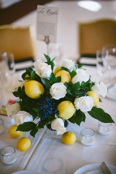 Give your wedding centerpiece a fresh spin with added lemons, like this one from All You Need Is Love Events. This takes an ordinary, simple white rose centerpiece to the next level!