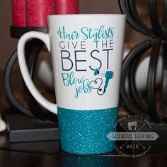 "Featured here is our Hair Stylist Humor Mug.  This mug reads ""Hairs Stylist Give the Best Blow Jobs"". A cute, unique and fun mug for any hair stylist! The print is professionally printed on and is dishwasher save (if glitter isn't chosen)!  The print is teal, black, and gray, but can also be changed for no extra charge.  The textured glitter dipped bottom is sealed and will not flake off in your hands.  Every mug is handmade and therefor no two will be exactly alike.  To ensure that your…"