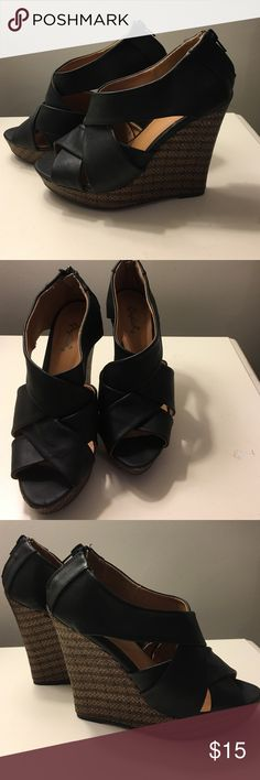 Black and brown wedge heels. Black faux leather heel with a brown and black weaved wedge. Shoes Wedges