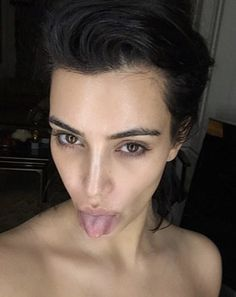 North West's mom went topless for the photo and without any makeup. She kept her dark locks up and stuck out her tongue.
