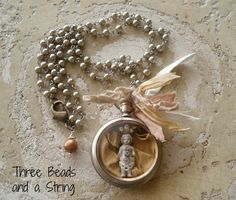 Vintage pocket watch Necklace with Frozen by threebeadsandastring