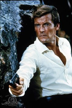 """Still of Roger Moore in The Man with the Golden Gun/****He was a good 007, but hard to take him as """"for real"""" as some of the others. He seemed a bit spoofy."""
