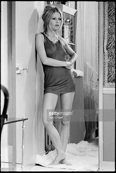 French actress and sex symbol Brigitte Bardot in negligee waits on set during the filming of The Novices, Les Novices.