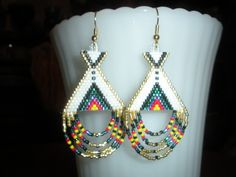 Hand beaded earrings TeePee Native American. $24.99, via Etsy.