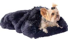 """This dog bed is a cozy snuggle sack plush that is made with a  super soft plush faux fur. Use it a a bed, a blanket and even a sleeping-bag when on the road. One size 24"""" x 30"""". More color available."""