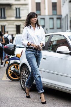 Classic style street style picture of girl in white button down, jeans and black pumps at milan fashion week
