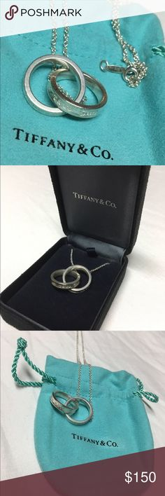 Tiffany's 2 ring necklace About 8 years only. Just professionally clean by the Tiffany's store @ Ross park mall in Pittsburgh, PA. Comes with blue bag, original Tiffany's black jewelry box, and blue Tiffany's box. Almost like new only thing missing is the bow! Would make a great Christmas gift for any luck girl! Tiffany & Co. Jewelry Necklaces
