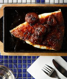 Toasty wedge of golden crusted kefalograviera cheese with baby figs in honey balsamic pepper sauce   Hellenic Republic   Gourmet Traveller