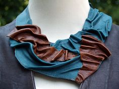 Received my beautiful leather bib necklace. It is very unique and well made. Very fast shipping and and a handwritten note. Seller really tries to please. Will order from again. Thanks! skayruth.    This is a lovely teal and brown leather bib necklace in an original wave pattern. This handmade piece has lots of detail. The perfect elements come together to make this a beautifully designed, one of a kind piece. A fashionable and fun necklace that is sure to add punch to your accessory…