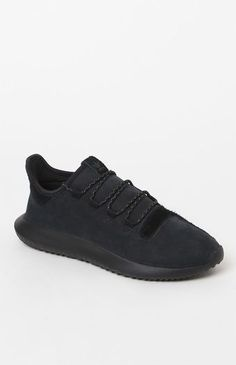"""Keep your sneaker game fashion-forward with help from the adidas Tubular Shadow Shoes. These modern kicks boast an EVA midsole for lightweight cushioning, an asymmetrical upper made with a mix of nubuck and suede, and a """"burrito"""" tongue that has a contoured design for a snug fit.    Asymmetrical upper with suede on lateral side and nubuck on medial  """"Burrito"""" tongue has a contoured design for a snug fit  Reflective laces  OrthoLite® sockliner EVA midsole for lightw..."""