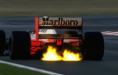 Ayrton Senna's Honda V12 powered McLaren MP4 spits flames on downshift during the 1992 Formula 1 Grand Prix season.