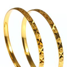 A pair of Handmade Indian bangles decorated with an engraved pattern of diagonal cuts and circles.  Only £8.99