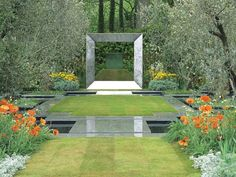 A contemporary garden features a water cube, steel frame, reflecting pools, and symmetrical plantings. Pops of orange and yellow poppies decorate the garden.