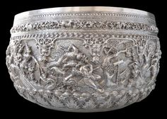 Monumental Repoussed Silver Bowl Maker: Maung Shwe Yon, Rangoon, Burma 1880  diameter: 45cm (17 inches), height: 25cm, weight: approximately 6,000g A wide border around the lower section of the bowl comprises repeated, prominent leaf motifs. A thinner border nearer the top features scrolling leaf forms  interspersed with the twelve animals of the Burmese zodiac.