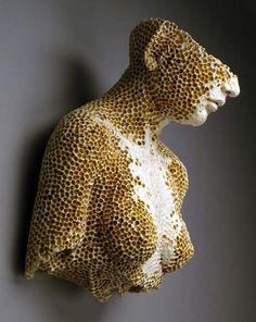 """Adrian Arleo - """"Hive Bust"""" (2005). Clay, glaze, wax encaustic, 17 x 16 x 11″, wall piece."""