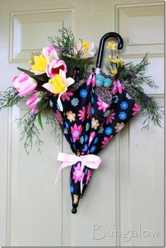 Child's umbrella for springtime door decor...perfect for a bridal or baby shower too.