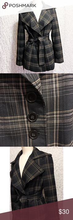Nine West Short Trench Coat (Belted) Nine West Suit Jacket. Size 4. With belt. Black with tan plaid pattern. Excellent condition. Gorgeous jacket! Has pockets.   68% Polyester. 30% Rayon. 2% Spandex.  Lining is 100% Polyester.   Measures 18 inches armpit to armpit (when buttoned). 28 inches long. Sleeve measures 23.5 inches from shoulder seam. Nine West Jackets & Coats Trench Coats