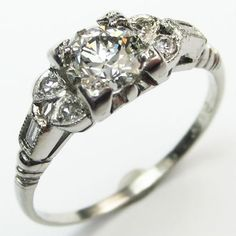 Sweet Romance: A beautiful ring with delicate proportions, but bold design.  Ca. 1930.  Maloys.com