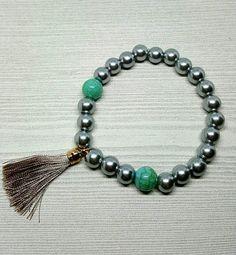 Check out this item in my Etsy shop https://www.etsy.com/ca/listing/510143354/tassel-bracelet-beaded-bracelet-boho