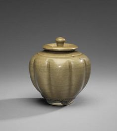 An unusual green-glazed lobed jar and cover Tang Dynasty/Five Dynasties