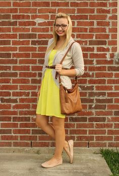 back to school outfit. yellow dress with light brown cardigan, flats, and purse.