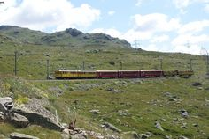 The two historic motor cars ABe 4/4 30 and ABe 4/4 34 drive on 11.8.09 with an extra train from Ospizio Bernina downhill.