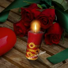 Red hand-painted Candle for Diwali Festival.