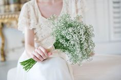 Antique lacy looking wedding dress. Baby's breath bouquet.