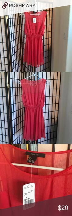 Forever 21 Red Orange Dress Size Small Beautiful flowy dress from Forever 21! Brand new with tags. Never worn. I did notice it has a tiny hole next to the tag as shown in photo. Forever 21 Dresses Midi