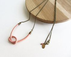 Pink leather knot  long necklace, antique brass chain
