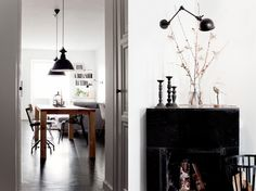 I love the simplicity and the dark contrasting furniture with light walls