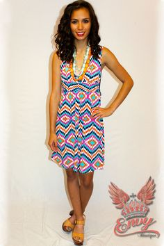 Prism & Crotchet Dress - Bold to behold in a simple and chic geometric printed tank dress. With a cinched waist and a crotchet back this vibrantly printed aqua, magenta, and navy dress is definitely fun and flirty creating a casually chic appearance. A perfect number for so many spring and summer nights! Wear with sandals or wedges and funky jewelry for a colorful look.  - available online at http://www.envyboutique.us/shop/prism-crotchet-dress/ #Envy #Boutique #chic #fashion