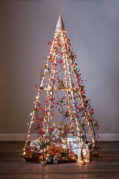 frame christmas tree - I love how the gifts nest inside the tree
