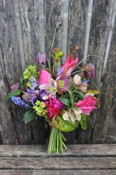 Pretty spring wedding bouquet with tulips, snakes head fritillary and hellebores // Lock Cottage Flowers