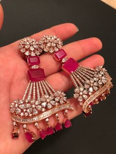 NEW Arrival, pink ruby American diamond statement earrings, statement jewelry. Indian Jewelry Earrings, Gold Bridal Earrings, Indian Jewelry Sets, Fancy Jewellery, Jewelry Design Earrings, Gold Earrings Designs, Hand Jewelry, Gold Jewellery Design, Bridal Jewelry Sets