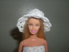 Crochet for Barbie (the belly button body type): White Shell Hat    (this web site has lots of crocheted Barbie clothes)