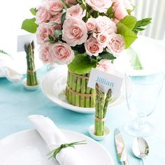 Create a pretty Flower Centerpiece with Asparagus. Here's How: http://www.bhg.com/holidays/easter/decorating/easter-table-setting-ideas/#page=5