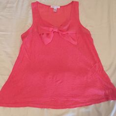 Cute peachy colored tank top Cute peachy colored tank top with a bow !!! Size S , only worn a few times . Ambiance Apparel Tops Tank Tops