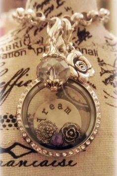 Origami Owl living locket... FREE CHARM WITH A $25 OR MORE PURCHASE... Contact me to place your order YourCharmingLocket@gmail.com or message me on Facebook https://www.facebook.com/YourCharmingLocket. Want more than just one locket, consider joining our team for an extra income.