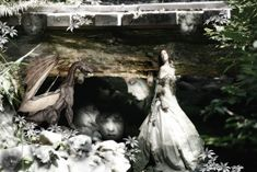 Ok....so back to the forest and all the strange creatures that inhabit the mossy rocks and trees and little bridges over fern covered streams. Here is a small Dragon and another forest fairy surrounded by strange rocks with faces. Model http://lockstock.deviantart.com/ Dragon http://alegion-stock.deviantart.com/ Background my stock/photograph
