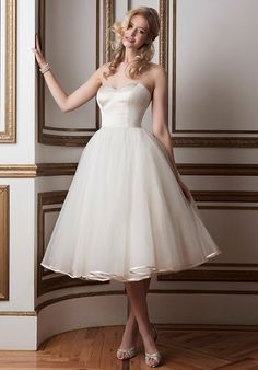 Regal satin and tulle tea length ball gown accented by a sweetheart neckline.
