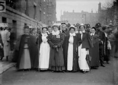 Nurses and midwives participating in the Pageant of Women's Trades and Professions, held on 27 April 1909 at the Albert Hall. The workers, who were part of the Suffragist International Congress which was meeting concurrently in London, marched in their uniforms to the Albert Hall from Eaton Square.        Production Date:      1909-04      ID no:      IN1308