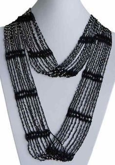 Black handmade infinity scarf with silver beads.
